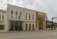 Buildings — Ripley, Ohio (Pythaglio) Tags: buildings structures historic ripley ohio unitedstatesofamerica us twostory brick storefronts altered browncounty street sidewalk commercial roundarched 11windows crossettes keystones bank sullivanesque