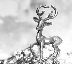Silver-coloured deer (7 Blue Nights) Tags: jewelry macromondays monday macro blackandwhite bw mono monochrome deer snow tin rx10 lookingcloseonfriday silvercoloured