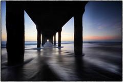 Under the Pier. (drpeterrath) Tags: pier seascape longexposure manhattan beach water ocean sun sky cloud wave pacific sand california calilife losangeles color outdoor captureone canon 5dsr eos sunset sunrise