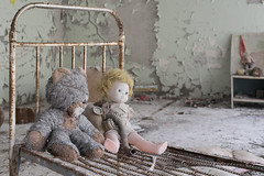 Golden Key Kindergarten (Jonnie Lynn Lace) Tags: abandoned ukraine chernobyl pripyat kindergarten при́пять чорнобиль dolls toys light day shadows interior classic history time nuclear disaster white blue yellow ruins ruinas nikkor nikon d750 50mm digital flickr travel trip europe european exploration explore urbex texture textures derelict decay detail rust memories window bed details depth dof doll gasmask teddybear jonnielace