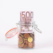Euro banknotes in a glass jar