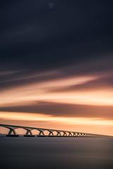 Into the unknown (Bilderschmied-Danz) Tags: holland netherlands zeeland zeelandbrug brücke bridge wasser water sonnenuntergang sunset wolken clouds langzeitbelichtung longexposure bilderschmied