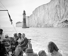 Lighthouse viewed from the boat (vintage ladies) Tags: vintage blackandwhite photograph photo man male woman women lady ladies hat lighthouse cliffs