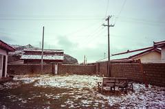 Snow in the Yard (hiphopmilk) Tags: copyright©jaredyehwooehmoehfilms konica offroad 現場監督 zoom 35mm 135film film analog analogue jaredyeh hiphopmilk kodak travel china sichuan aba hongyuan qiongxi qiongxizhen tibetan longrang snow village yard workshop pole