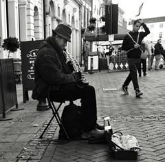 Painful Sounds? (Bury Gardener) Tags: suffolk streetphotography street snaps streetcandids strangers people peoplewatching candid candids burystedmunds britain 2018 england eastanglia bw blackandwhite monochrome mono abbeygatestreet
