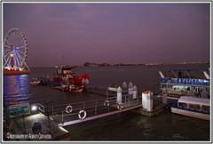 ATRACCIONES EN LA CIUDAD. ATTRACTIONS IN THE CITY. GUAYAQUIL  ECUADOR. (ALBERTO CERVANTES PHOTOGRAPHY) Tags: attractioninthecity guayaquilecuador guayaquil ecuador gye rioguayas guayas rio river sea ocean lake republicadelecuador ecuadorgye gyeecuador muelle dock peer barco boat ship yacht fluvial malecon2000 malecon ferriswheel wheel ferris sunset dusk twilight nightfall water duran retrato portrait streetphotography photography photoborder photoart art creative indoor outdoor blur sky clouds reflejo reflection hill city purple ruedamoscovita moscovita noria laperla wheelofthefortune fortune light colorlight color colores colors brightcolors brillo bright nightcolor cityscape attraction puente bridge laperlaguayaquil noriadeguayaquil giant giantwheel
