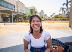 Happy young Asian woman laughing in public park (Apricot Cafe) Tags: imgr17917 asia filipinoethnicity healthylifestyle manilaphilippines millennialgeneration philippines positiveemotion southeastasianethnicity bonifacio buildingexterior candid carefree casualclothing copyspace day enjoyment freedom grass happiness honesty joy laughing leisureactivity lifestyles morning oneperson oneyoungwomanonly outdoors people photography publicpark purity realpeople sitting sky southeastasia springtime tourism tourist traveldestinations waistup weekendactivities women youngadult