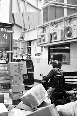 Trade and Commerce | Hong Kong (香港), China (Ping Timeout) Tags: hong kong hongkong china sar 香港 island south special administrative region people's republic prc territory december 2018 vacation holiday trip 香港特區 香港特区 trade commerce lorry truck black white bw monochrome street photography people person shipment box goods items carton alley store window scene urban city central area outdoor work port hub iherb motorcycle delivery load unload logistics
