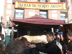 Pork on a spit,  The Cervantine Fair, Alcalá de Henares, October 2018 (d.kevan) Tags: cervantinefair alcaládehenares october 2018 streetscenes stalls signs people madrid meat pork spit cook food awnings