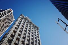 Vancouver Block under blue sky (Eric Flexyourhead) Tags: vancouver canada britishcolumbia bc downtown granvillestreet vancouverblock building architecture old heritage sky clear blue bluesky blueskies ricohgr