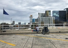 Lovers (moke076) Tags: lovers varsity people random man woman atlanta ga wheelchair disabled parking deck flag olympic state torch buildings couple partners embrace romantic iphone cellphone mobile candid portrait