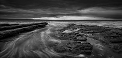 Buoy (paullangton) Tags: wales blackandwhite water clouds jurassic contrast mono coast nashpoint monknash rain storm lee longexposure