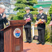Naval officers delivers remarks at a commemoration for the 2011 Great Tohoku Earthquake in Sasebo, Japan