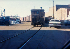 Soo Line Kingsbury at Wisconsin Chicago IL November 1988 (Tom J. Burke) Tags: ce chicago railroad streettrackage soo kingsbury chicagoevanston caboose taxi cab
