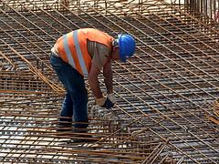 Construction worker. (robárt shake) Tags: construction worker bauarbeiter stahlbeton arbeiten working arbeitskleidung schutzhelm helmet schutzweste schutzhandschuhe anstrengend mühevoll unterbezahlt gefährlich job baustelle fundament stahlbetonbauer betonbauer beton niedriglohnsektor