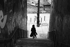In the middle of walls (pascalcolin1) Tags: paris13 femme woman ombre shadow lumière light escalier stairs barriere barrier murs wall tags arbre tree manteau coat photoderue streetview urbanarte noiretblanc blackandwhite photopascalcolin 50mm canon50mm canon