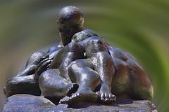 Cuddle Up (Scott 97006) Tags: statue metal embrace cuddling art beauty man woman embracing comforting love metalic