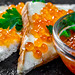 Salmon red caviar on white bread with parsley leaves