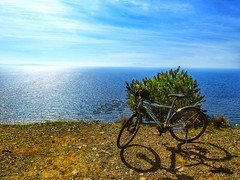 the view and the shadow (panoskaralis) Tags: bike idealbikes cycle view horizon blue bluesea bluesky sea sky skyclouds clouds outdoor landscape nature seafarm seascape lesvosisland lesvos mytilene greece greek hellas hellenic nikoncoolpixb700 nikon nikonb700 aegean aegeansea greekisland greeknature