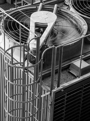 Beating Up the Air (Steve Taylor (Photography)) Tags: ac airconditioningunit fan ladder hotel architecture building monochrome blackandwhite metal asia city singapore blur