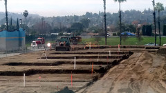 (Rich T. Par) Tags: pomona phillipsranch socal southerncalifornia losangelescounty lacounty constructionsite california palmtrees tree suburb dirt civilengineering sky frontloader heavyequipment road parkinglot fence chainlinkfence constructionvehicles tractor truck