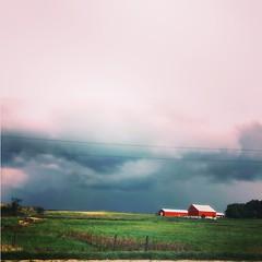 Stormy sky (jessalynn_sammons) Tags: field iphone redbarn barn stormy stormysky clouds sky storm