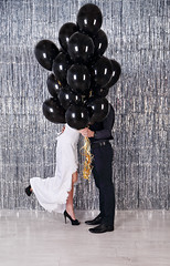 hiding behind balloons (mallivan) Tags: love young happiness woman hide kiss secret shut couple fun wedding beautiful people dress happy man together romance white married female romantic bride marriage two balloons birthday male girl groom balloon celebration boyfriend holding day family smile joy helium dating flying men studio black valentine background silver holiday stylish creative
