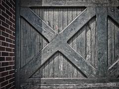 Weathered Door (Randall McRoberts) Tags: indiana indianapolis architecture brick brickbuilding door garfieldpark