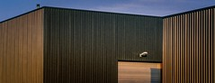 Factory Facades 2 (rob kraay) Tags: aluminiumbuilding flatroof chimney robkraay outdoorlightning roofedge bluesky rollerdoor shadow