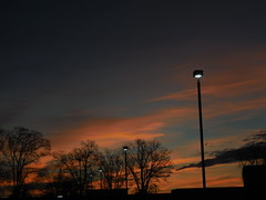 DSCN7302 (tombrewster6154) Tags: sunrise pretty beautiful orange pink clouds greensboro nc friendly center parking lot early morning dawn winter february street lamp light natural artificial