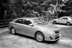 2013 Toyota Camry (Matthew Paul Argall) Tags: canonsnappy20 fixedfocus 35mmfilm blackandwhite blackandwhitefilm kentmere100 100isofilm car vehicle automobile transportation familysedan sedan carspotting