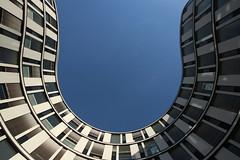 Into the blue sky (Elbmaedchen) Tags: hamburgerwelle architektur architecture linien kurven gebäude office glasfassade rund roundandround lines curves hamburg