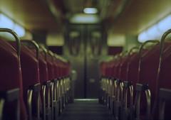 Metra Train Interior (Jovan Jimenez) Tags: canon plustek eos opticfilm rebel 8200i t2 hasselblad carl zeiss plannar 80mm f28 lomography 800 35mm film metra train interior bokeh tiltshift arax 300x kiss7