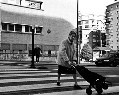 you gotta carry that weight (theoswald) Tags: streetphotography street leicahuawei p20 mobilephotography blackandwhite lady crossing