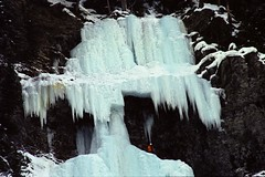 The Ice Climber 1 (pmvarsa) Tags: winter 2002 analog film 135 cans2s kodak royal gold 200iso kodakroyalgold200 royal2002 nikonsupercoolscan9000ed nikon coolscan cold snow ice frozen rocky moutains mountain national park nature water waterfall falls sport activity outdoor climbing person climber canon ftb canonftb classic camera banff lakelouise alberta canada ab
