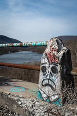 """...UNTIL WE DROWN"" (Greg Adams Photography) Tags: delawareriver bridge abandoned pilar graffiti forgotten decay spring 2019 pennsylvania pa nj border hhsc2000 sky frown face complaint poconos delawareriverviaduct"