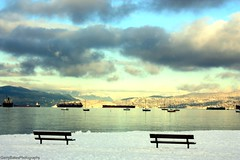 Burrard Inlet Winter Sunrise (gerry.bates) Tags: kitsilanopark kitsbeach vancouver bc canada winter snow sunrise water burrardinlet ocean freighters boats sailingboats yachts mountains northshoremountains coastal clouds sky weather