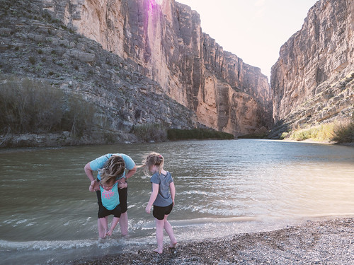 Dipping their toes in the Rio Grande River