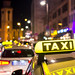Taxi waiting for a ride at night.