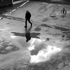 His head in the clouds (pascalcolin1) Tags: paris13 austerlitz homme man eau water pluie rain reflets reflection nuages clouds tête head photoderue streetview urbanarte noiretblanc blackandwhite photopascalcolin 50mm canon50mm canon