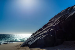 Rocks, Sand, Sun and Ocean (KVSE) Tags: pacific pacificocean baja bajacaliforniasur mexico bajapenninsula cabosanlucas sun horizon seaofcortez sand beach rocks rock granite surf