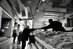 Fish Seller (Bury Gardener) Tags: monochrome mono burystedmunds bw blackandwhite britain suffolk streetphotography street streetcandids snaps strangers candid candids people peoplewatching folks nikond7200 nikon england eastanglia uk 2019 cornhill