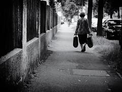 way home (Sandy...J) Tags: olympus urban city street streetphotography sw strasenfotografie stadt monochrom women walking blackwhite bw germany deutschland photography fotografie absoluteblackandwhite