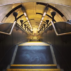 Going down (vapour trail) Tags: tube underground metro station travel transport hub tunnel steps light stairs hand rail yellow st johns wood london tfl