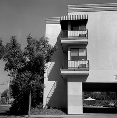 Lodi, CA (bingley0522) Tags: rolleiflexautomatmxevs carlzeisstessar75mmf35 yellowfilter trix diafine epsonv500scanner lodi centralvalley smalltowns apartments urbanlandscape urbanarchitecture autaut ordinarythings commonplacethings