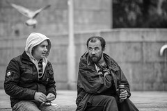 Two men: happy out! (Frank Fullard) Tags: frankfullard fullard candid street portrait pair couple dove pigeon drink cigarettes can hoodie alcohol happyout slang galway irish ireland monochrome black white blanc noir happy