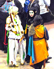 Discussing Boyfriends (Steve Taylor (Photography)) Tags: pixie pointedears sword knives cloak colourful cloth people women addington armageddonexpo armaggedon costume outfit wig