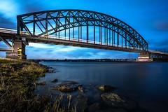 Spporbrug bij Arnhem in Meinerswijk (Maarten Takens) Tags: brug arnhem rhein rijn blauw sunset river rivier gelderland nederland blauwuur bluehour stones wind blau blauestunde