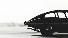 PMC Week 28 Entry - 'Essence' (at1503) Tags: bw blackandwhite jaguar etype britishcar classiccar iconic icon 1960scar jaguaretype japan hangar airport curve bodylines wheel car sky blur gtsport granturismo granturismosport motorsport racing game gaming ps4 competition