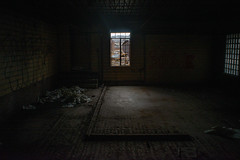 A Dark Room With a Bright Window (IAmTheSoundman) Tags: abandoned urbanexploring pennsylvania urbex chinafactory factory clutter messy sony a99 takumar vintagelens m42 manualfocus